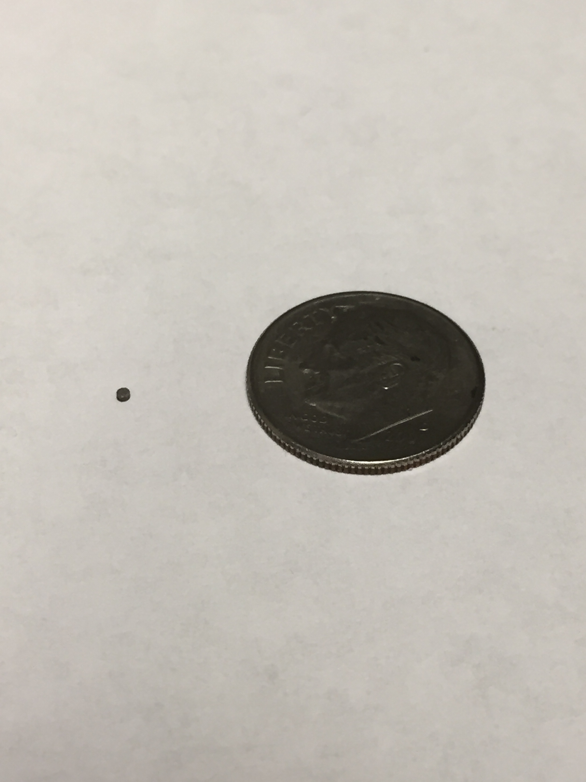 Micro Size Samarium Cobalt Magnet compared to dime